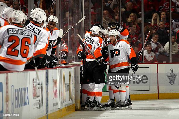 Matt Carle of the Philadelphia Flyers celebrates with his teammates after scoring a goal in the second period against Martin Brodeur of the New...