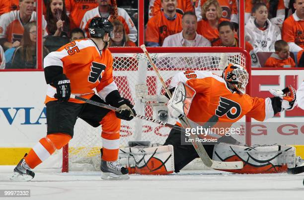 Matt Carle of the Philadelphia Flyers watches as his goaltender Michael Leighton makes a glove save against the Montreal Canadiens in Game Two of the...