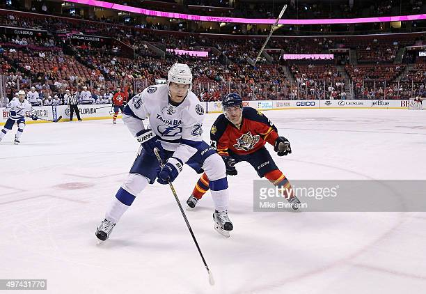 Matt Carle of the Tampa Bay Lightning and Rocco Grimaldi of the Florida Panthers fight for the puck during a game at BBT Center on November 16 2015...