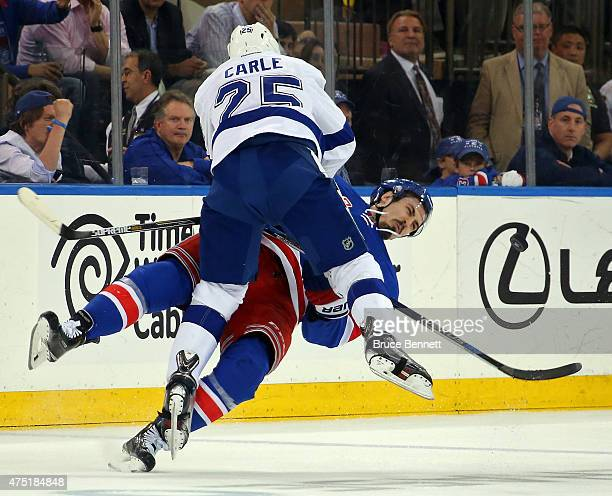 Matt Carle of the Tampa Bay Lightning checks Chris Kreider of the New York Rangers during the second period in Game Seven of the Eastern Conference...