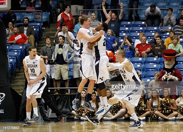 Matt Carlino Brock Zylstra Anson Winder and Nate Austin of the Brigham Young Cougars celebrate the Cougars 7872 victory against the Iona Gaels in the...