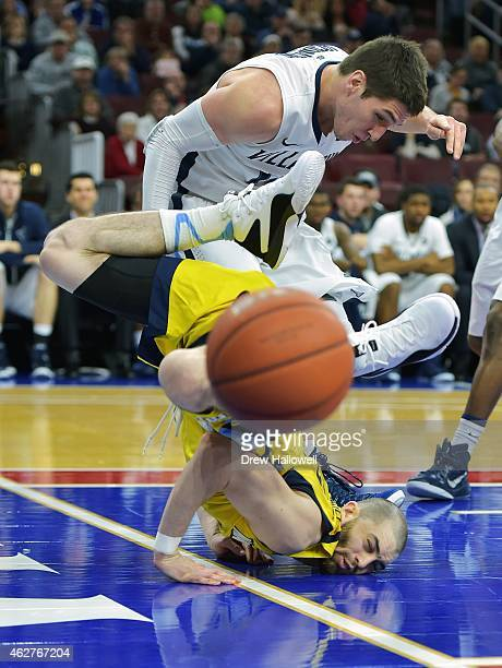 Matt Carlino of the Marquette Golden Eagles is upended by Ryan Arcidiacono of the Villanova Wildcats at the Wells Fargo Center on February 4 2015 in...