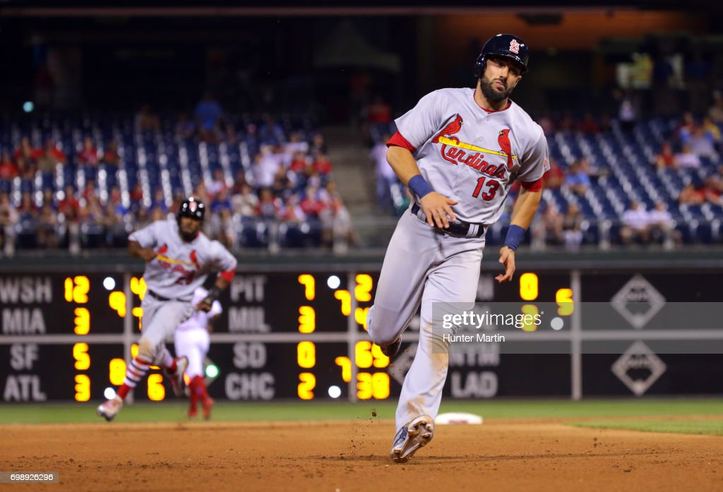 Matt Carpenter #13 and Dexter Fowler #25 of the St. Louis Cardinals run to third base on their way home to score the go ahead runs in the 11th inning during a game against the Philadelphia Phillies at Citizens Bank Park on June 20, 2017 in Philadelphia, Pennsylvania. The Cardinals won 8-1 in 11 innings.