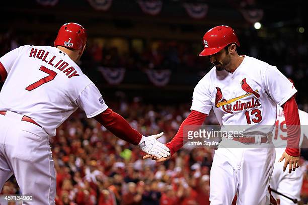 Matt Carpenter celebrates with Matt Holliday of the St Louis Cardinals after hitting a solo home run in the third inning against the San Francisco...
