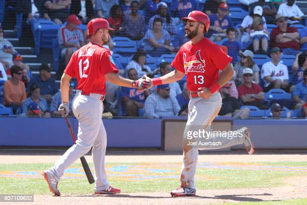 Matt Carpenter is congratulated by Paul DeJong after scoring on a double by Jose Martinez of the St Louis Cardinals against the New York Mets during...