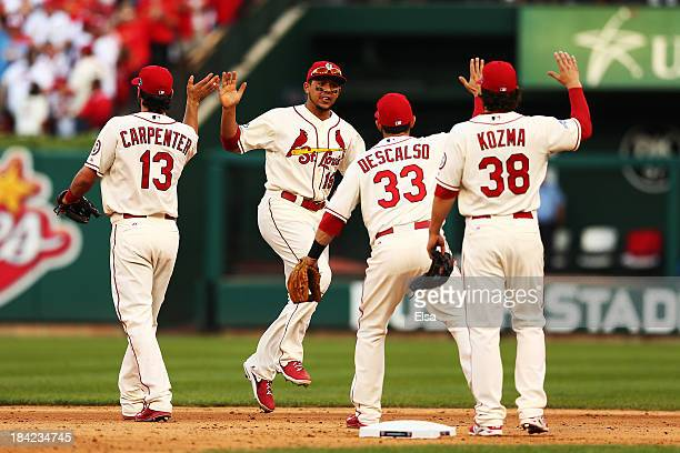 Matt Carpenter Jon Jay Daniel Descalso and Pete Kozma of the St Louis Cardinals celebrate their 1 to 0 win over the Los Angeles Dodgers during Game...