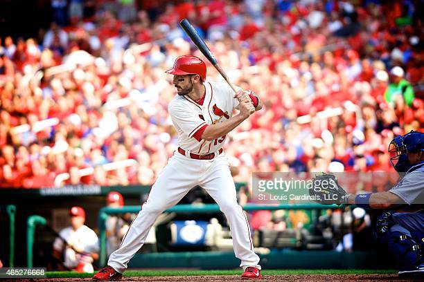 Matt Carpenter of the St Louis Cardinals assumes his batting stance while AJ Ellis catcher for the Los Angeles Dodgers waits for the pitch during a...