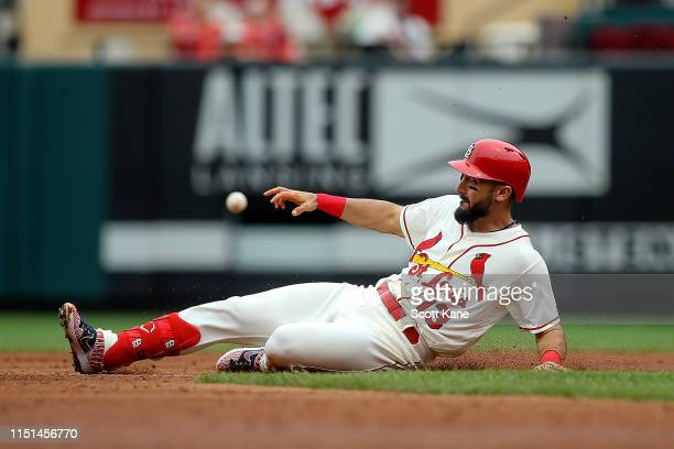 Matt Carpenter of the St Louis Cardinals beats the throw as he slides safely to second after hitting a double during the third inning against the Los...