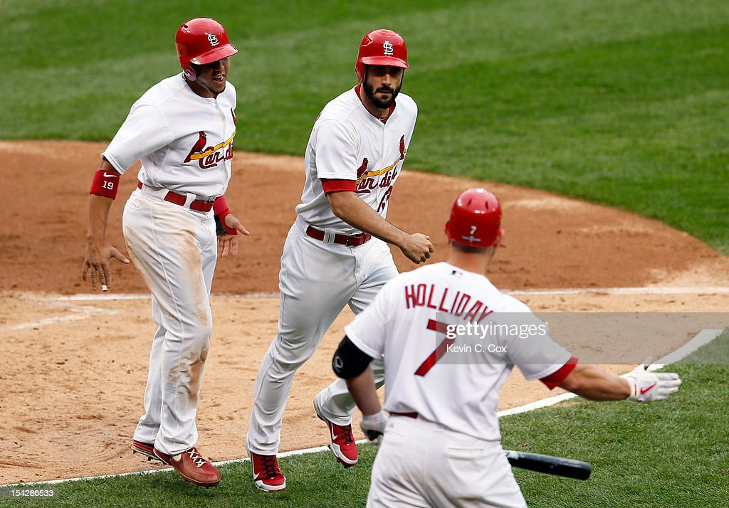 Matt Carpenter #13 of the St. Louis Cardinals celebrates after hitting a two-run home run with teammates Jon Jay #19 and Matt Holliday #7 in the third inning against the San Francisco Giants in Game Three of the National League Championship Series at Busch Stadium on October 17, 2012 in St Louis, Missouri.