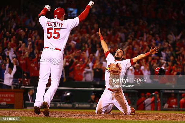 Matt Carpenter of the St Louis Cardinals celebrates after scoring the gamewinning run against the Cincinnati Reds in the ninth inning at Busch...