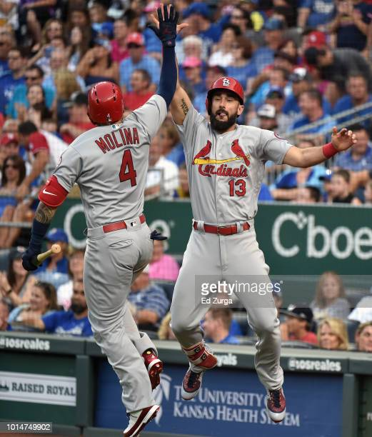 Matt Carpenter of the St. Louis Cardinals celebrates his two-run home run with Yadier Molina in the second inning against the Kansas City Royals in...