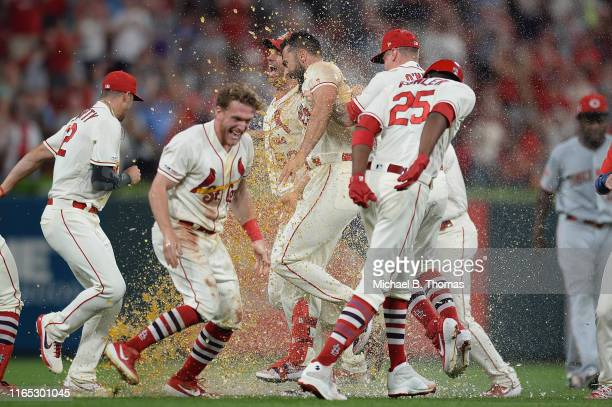 Matt Carpenter of the St Louis Cardinals celebrates with his teammates after hitting a gamewinning RBI single in the ninth inning against the...