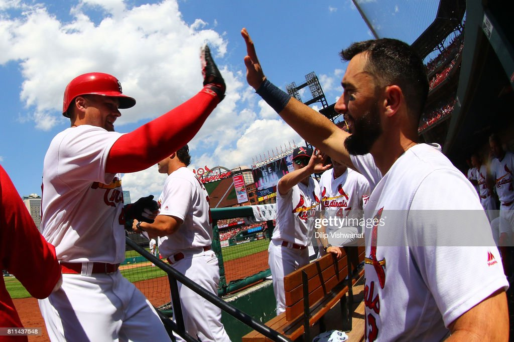 Matt Carpenter #13 of the St. Louis Cardinals congratulates Luke Voit #40 of the St. Louis Cardinals after Voit hit a home run against the New York Mets in the sixth inning at Busch Stadium on July 9, 2017 in St. Louis, Missouri.