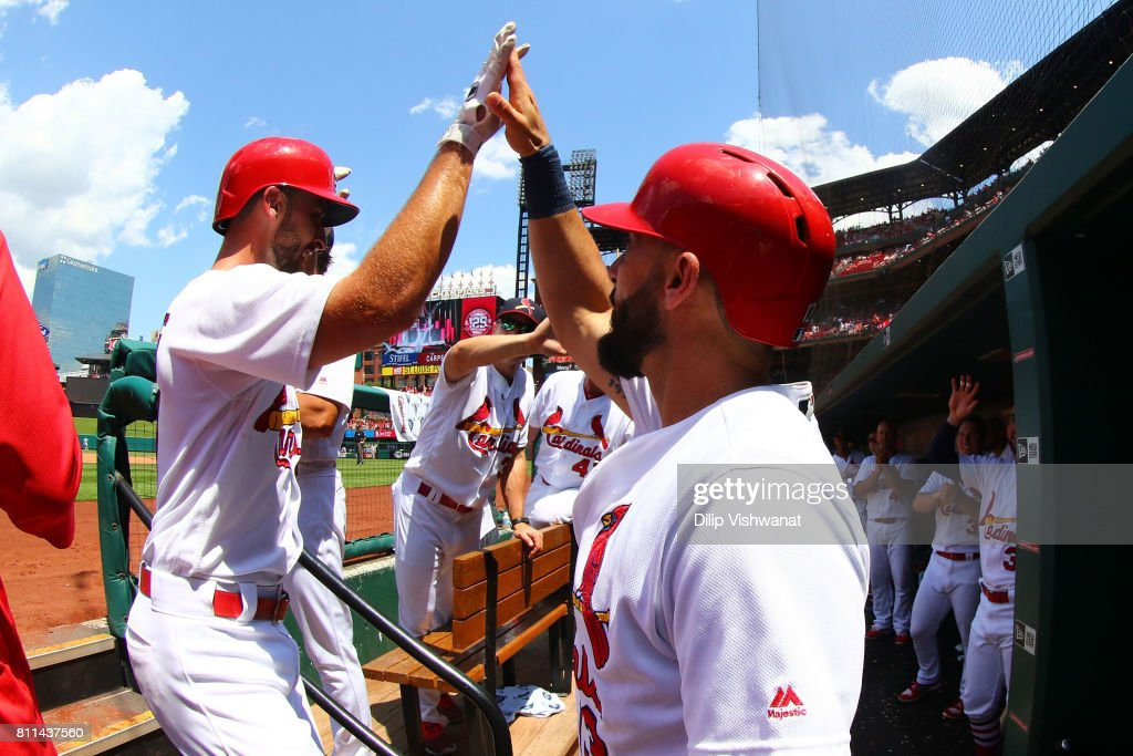 Matt Carpenter #13 of the St. Louis Cardinals congratulates Paul DeJong #11 of the St. Louis Cardinals after DeJong hit a home run against the New York Mets in the fourth inning at Busch Stadium on July 9, 2017 in St. Louis, Missouri.