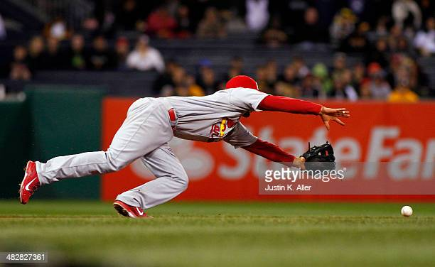 Matt Carpenter of the St Louis Cardinals dives and misses for a ball in the eighth inning against the Pittsburgh Pirates during the game at PNC Park...