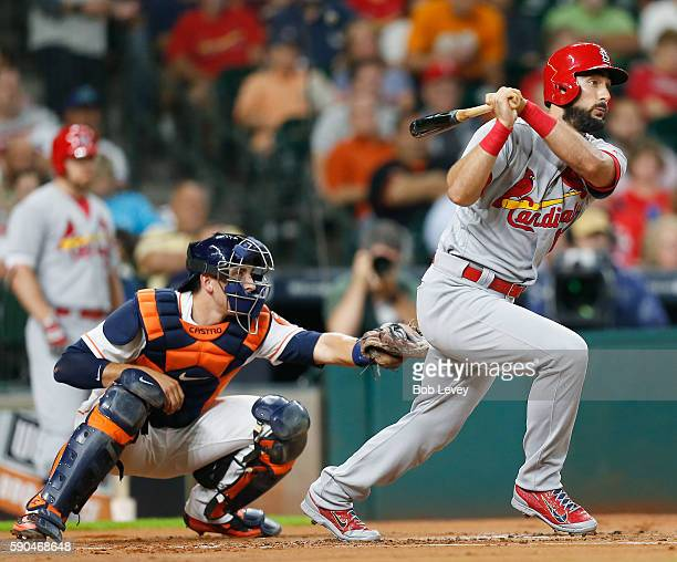 Matt Carpenter of the St Louis Cardinals doubles in the first inningagainst the Houston Astros as catcher Jason Castro looks on at Minute Maid Park...
