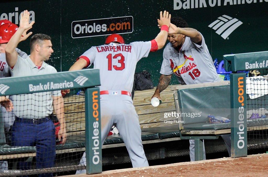 Matt Carpenter #13 of the St. Louis Cardinals has water thrown on him by Carlos Martinez #18 after hitting a home run in the sixth inning against the Baltimore Orioles at Oriole Park at Camden Yards on June 16, 2017 in Baltimore, Maryland. St. Louis won the game 11-2.