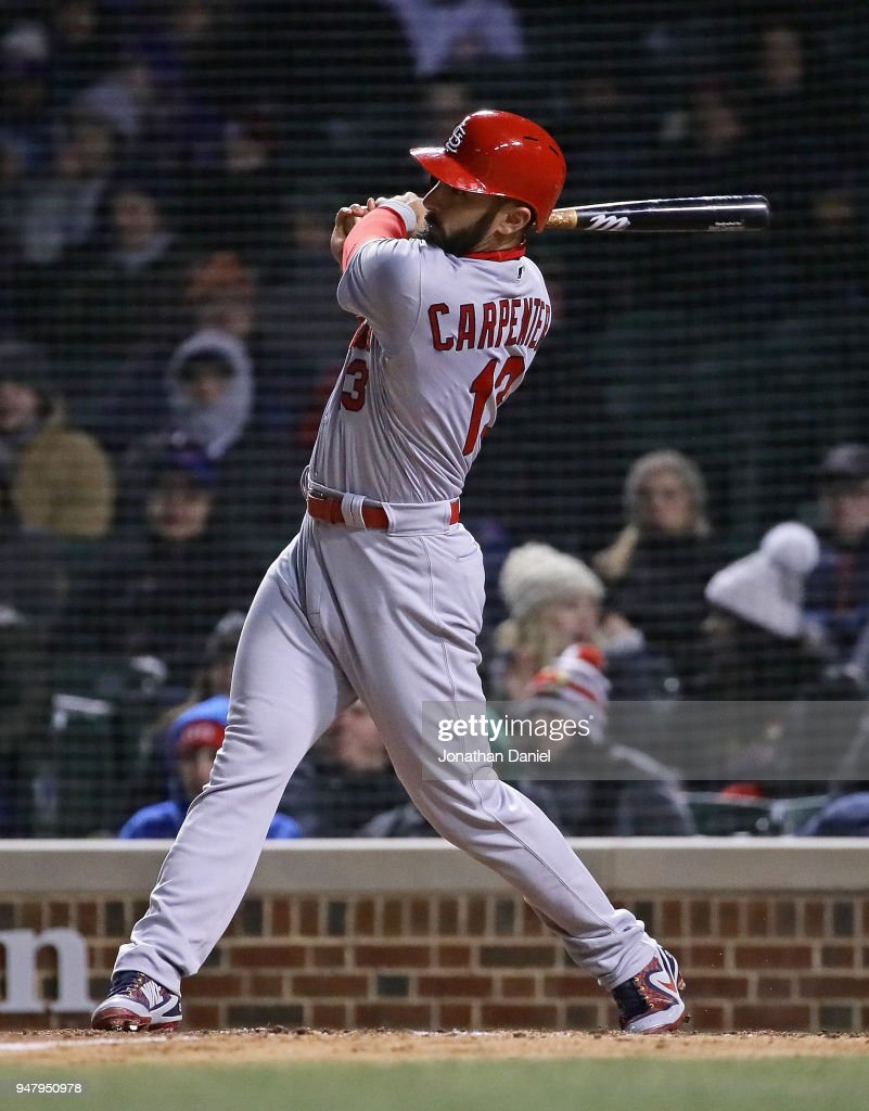 Matt Carpenter #13 of the St. Louis Cardinals hits a run scoring single in the 8th inning against the Chicago Cubs at Wrigley Field on April 17, 2018 in Chicago, Illinois.
