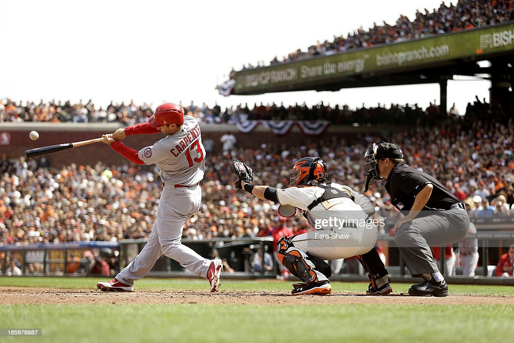 Matt Carpenter #13 of the St. Louis Cardinals hits a single that scored two runs in the fourth inning of their game against the San Francisco Giants at AT&T Park on April 7, 2013 in San Francisco, California.