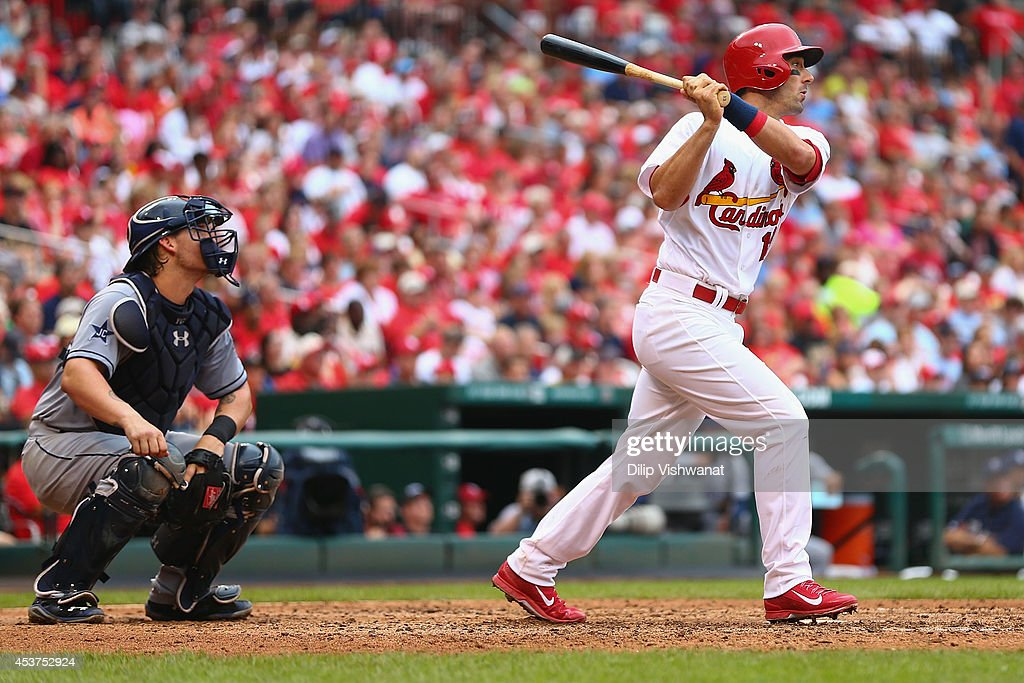 Matt Carpenter #13 of the St. Louis Cardinals hits a two-RBI double against the San Diego Padres in the sixth inning at Busch Stadium on August 17, 2014 in St. Louis, Missouri. The Cardinals beat the Padres 7-6.