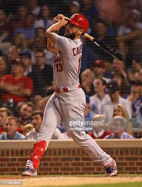 Matt Carpenter of the St Louis Cardinals hits the gamewinning solo home run in the 10th inning against the Chicago Cubs at Wrigley Field on September...