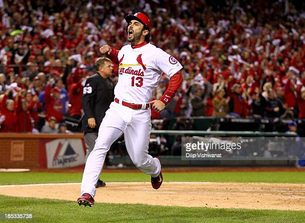 Matt Carpenter of the St Louis Cardinals reacts after scoring a run in the third inning against the Los Angeles Dodgers in Game Six of the National...