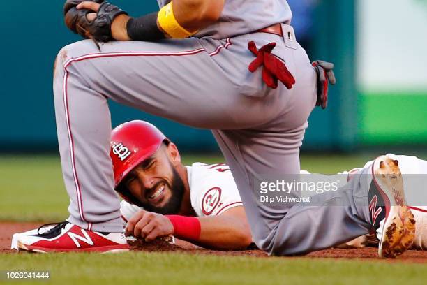 Matt Carpenter of the St Louis Cardinals reacts after sliding safely into second base against the Cincinnati Reds in the first inning at Busch...