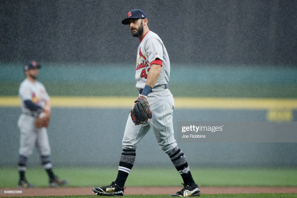 Matt Carpenter #13 of the St. Louis Cardinals reacts as a steady rain falls in the first inning of the game against the Cincinnati Reds at Great American Ball Park on April 15, 2018 in Cincinnati, Ohio. All players are wearing #42 in honor of Jackie Robinson Day.