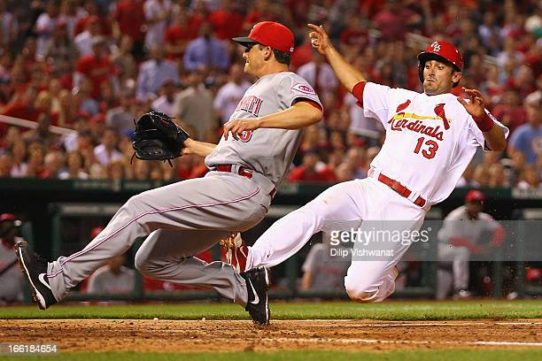 Matt Carpenter of the St Louis Cardinals scores a run on a wild pitch in the eighth inning against reliever Manny Parra of the Cincinnati Reds at...