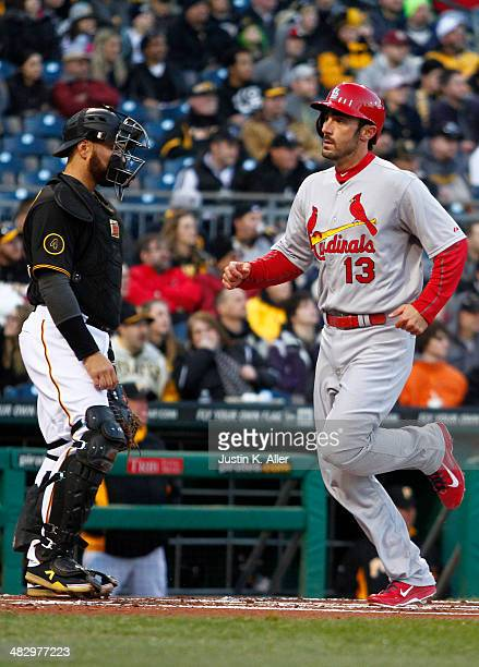 Matt Carpenter of the St Louis Cardinals scores on an RBI single in the first inning against the Pittsburgh Pirates during the game at PNC Park April...