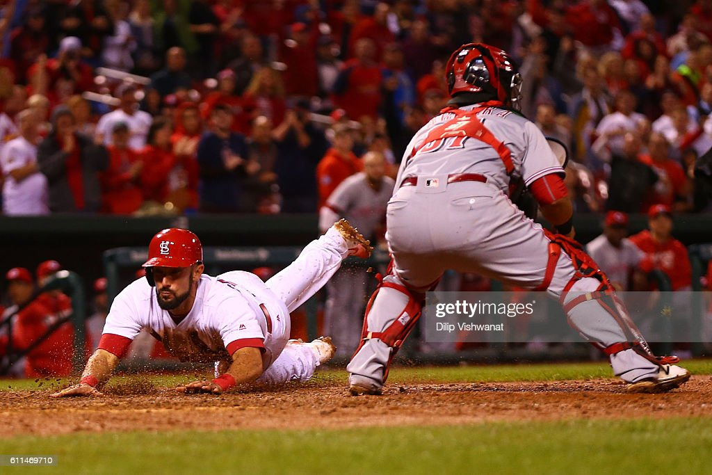 Matt Carpenter #13 of the St. Louis Cardinals scores the game-winning run against the Cincinnati Reds in the ninth inning at Busch Stadium on September 29, 2016 in St. Louis, Missouri.