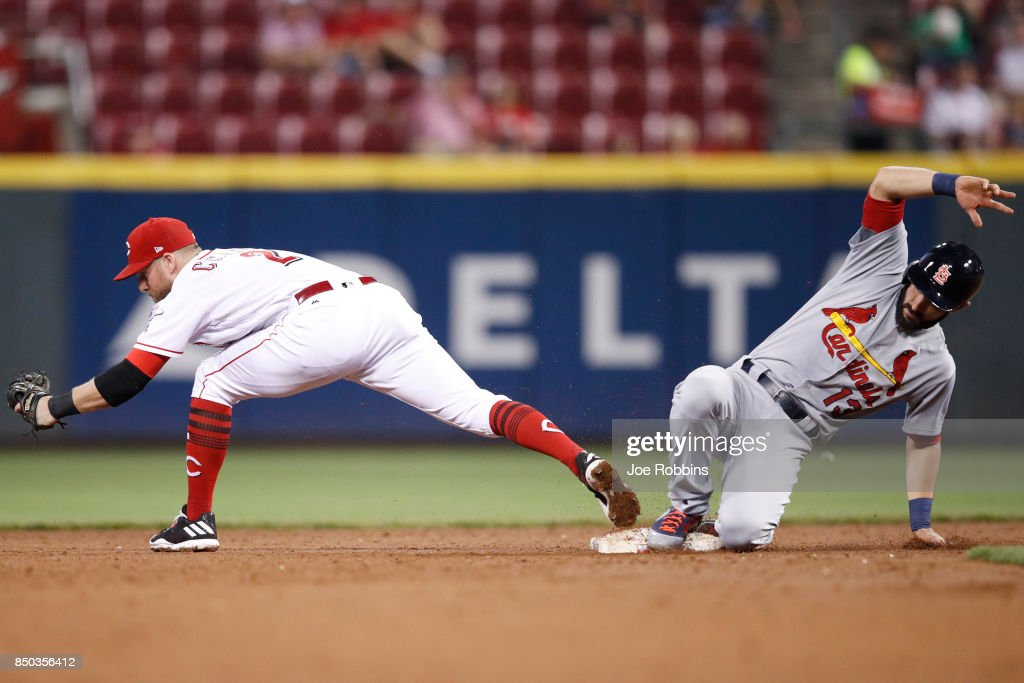 Matt Carpenter #13 of the St. Louis Cardinals slides into second base ahead of the throw to Zack Cozart #2 of the Cincinnati Reds in the sixth inning of a game at Great American Ball Park on September 20, 2017 in Cincinnati, Ohio. The Cardinals won 9-2.