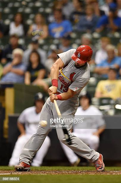 Matt Carpenter of the St Louis Cardinals swings at a pitch during the eighth inning of a game against the Milwaukee Brewers at Miller Park on August...