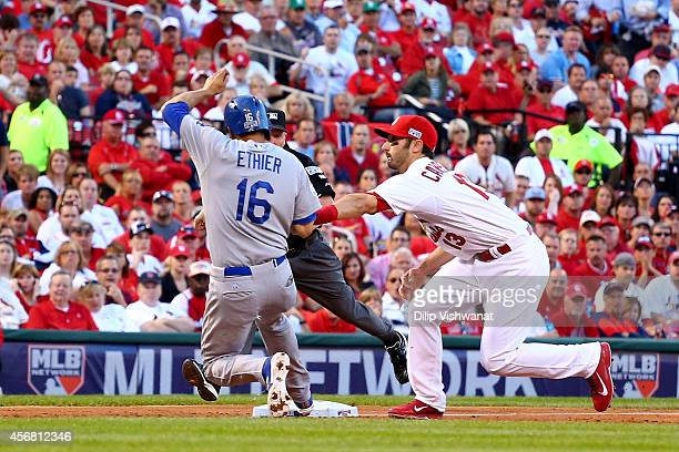 Matt Carpenter of the St Louis Cardinals tags Andre Ethier of the Los Angeles Dodgers in the sixth inning in Game Four of the National League Divison...