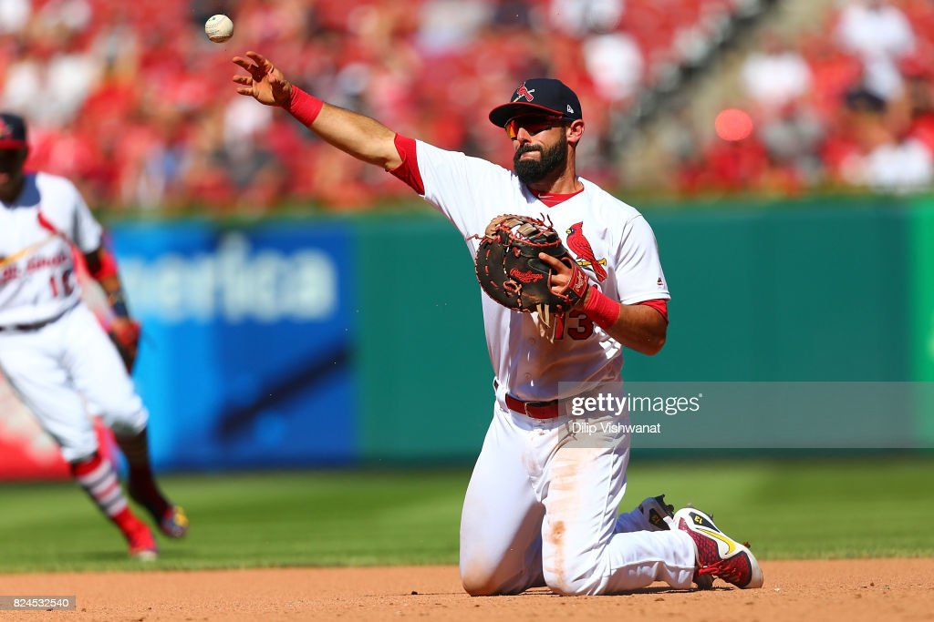 Matt Carpenter #13 of the St. Louis Cardinals throws to first base against the Arizona Diamondbacks in the eighth inning at Busch Stadium on July 30, 2017 in St. Louis, Missouri.