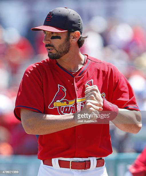 Matt Carpenter of the St Louis Cardinals watches the pitcher warm up prior to batting against the Atlanta Braves during a spring training game at...