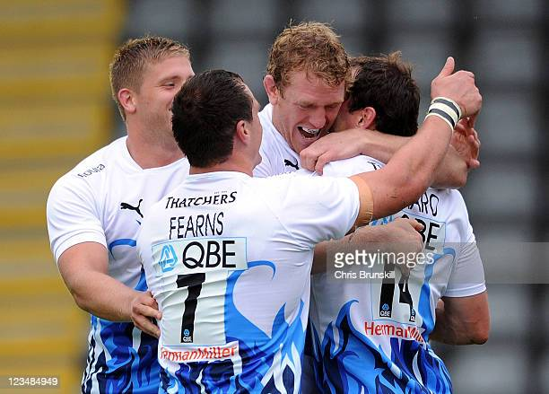 Matt Carraro of Bath is congratulated by his team-mates after scoring the opening try during the AVIVA Premiership match between Newcastle Falcons...