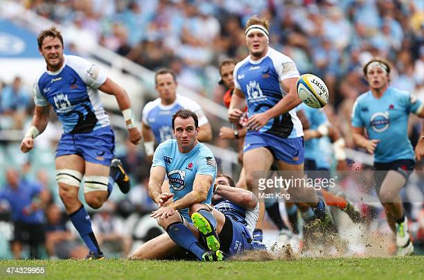 Matt Carraro of the Waratahs makes a break and offloads to Kurtley Beale for a try during the round two Super Rugby match between the Waratahs and...
