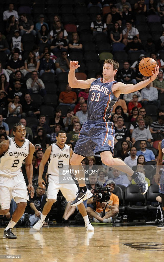 Matt Carroll #33 of the Charlotte Bobcats leaps in the air as he attempts to pass the ball during the game against the San Antonio Spurs at the AT&T Center on March 2, 2012 in San Antonio, Texas.