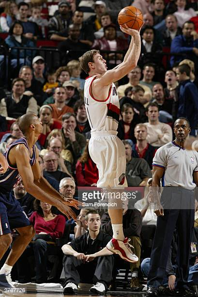 Matt Carroll of the Portland Trail Blazers takes a jump shot during a game against the New Jersey Nets on November 28 2003 at the Rose Garden Arena...