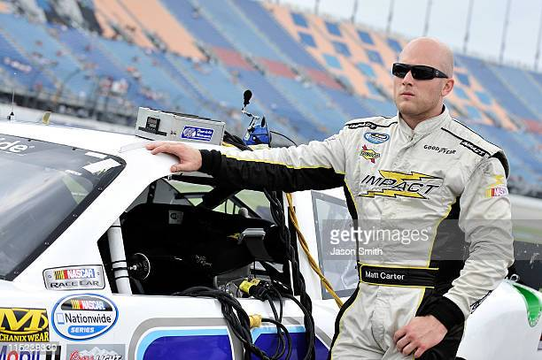 Matt Carter stands beside the Fleurdelis Farms Chevrolet during qualifying for the NASCAR Nationwide Series STP 300 at Chicagoland Speedway on June 4...