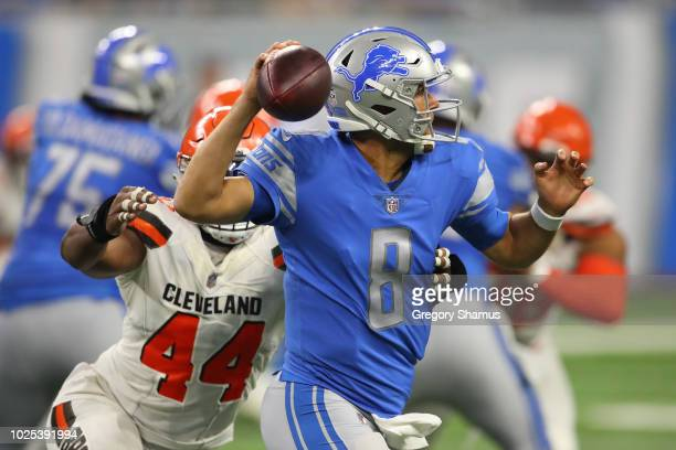 Matt Cassel of the Detroit Lions throws a pass while being pressured by Nate Orchard of the Cleveland Browns during a preseason game at Ford Field on...