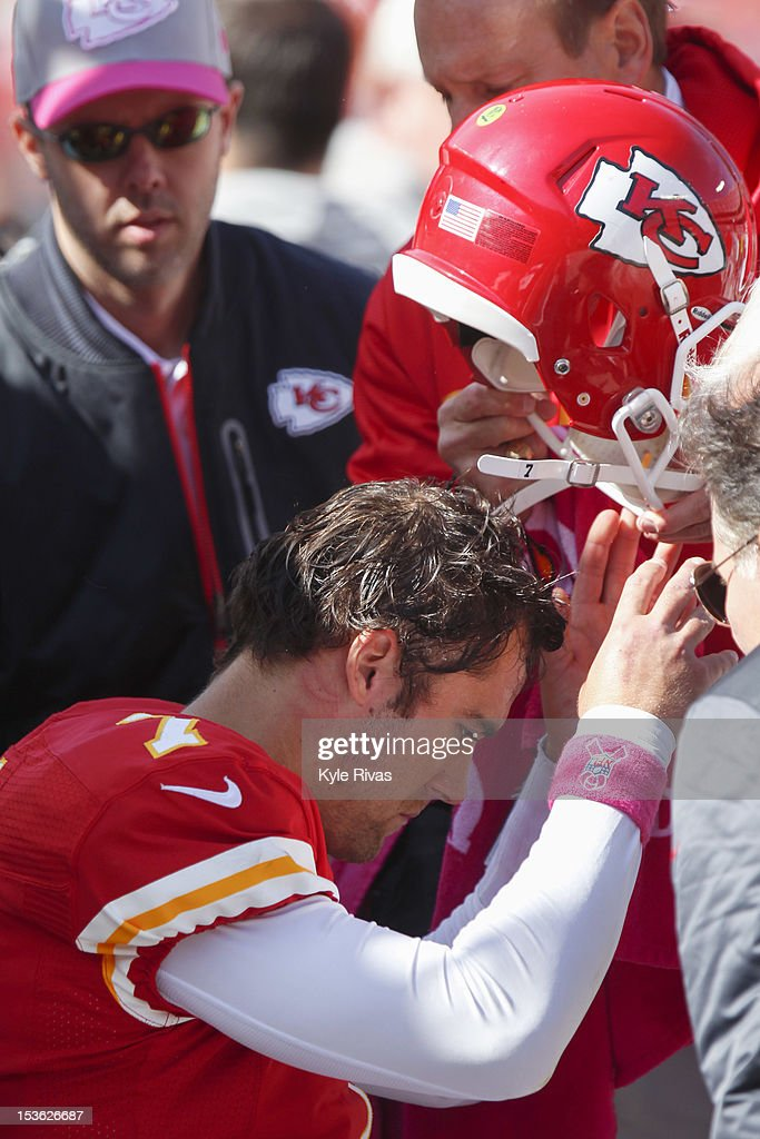 Matt Cassel #7 of the Kansas City Chiefs is examined after taking a hit from a Baltimore Raven and being helped off the field in the fourth quarter on October 07, 2012 at Arrowhead Stadium in Kansas City, Missouri.