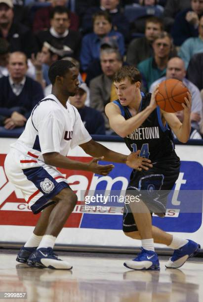 Matt Causey of the Georgetown Hoyas looks to drive on Ben Gordon of the University of Connecticut Huskies during the game on January 14, 2004 at the...