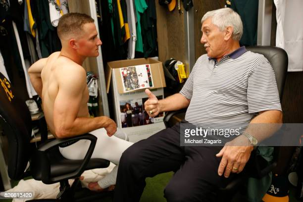 Matt Chapman and Broadcaster Ray Fosse of the Oakland Athletics talk in the clubhouse prior to the game against the Tampa Bay Rays at the Oakland...
