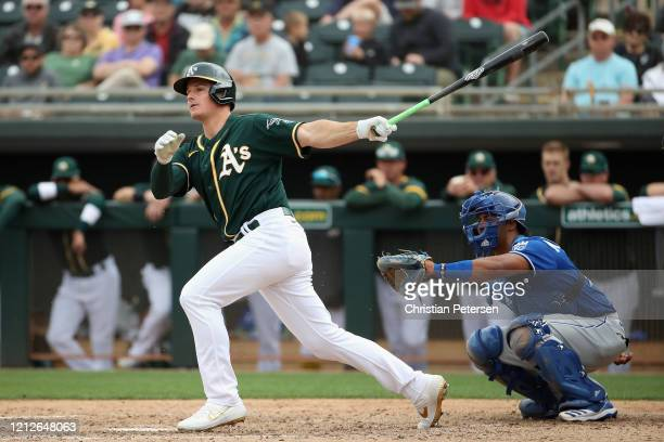 Matt Chapman of the Oakland Athletics bats against the Kansas City Royals during the MLB spring training game at HoHoKam Stadium on March 10, 2020 in...