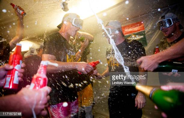 Matt Chapman of the Oakland Athletics celebrates clinching a wild card spot with teammates after the game against the Seattle Mariners at T-Mobile...