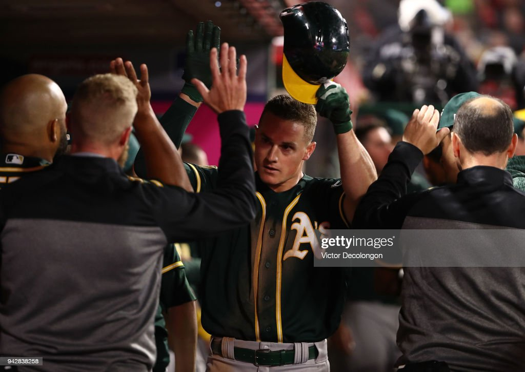 Matt Chapman #26 of the Oakland Athletics celebrates in the dugout after hitting a two-run homerun during the fifth inning of the MLB game against the Los Angeles Angels of Anaheim at Angel Stadium on April 6, 2018 in Anaheim, California.