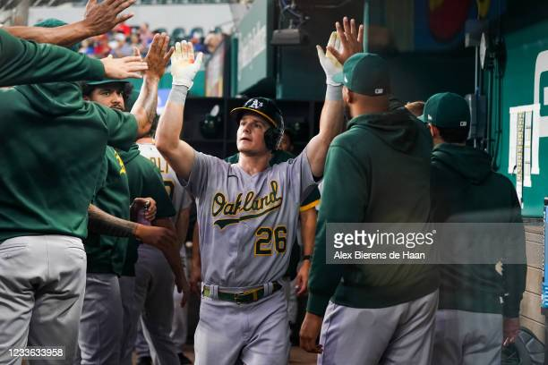 Matt Chapman of the Oakland Athletics celebrates scoring off the groundout from Chad Pinder in the first inning of the game against the Texas Rangers...