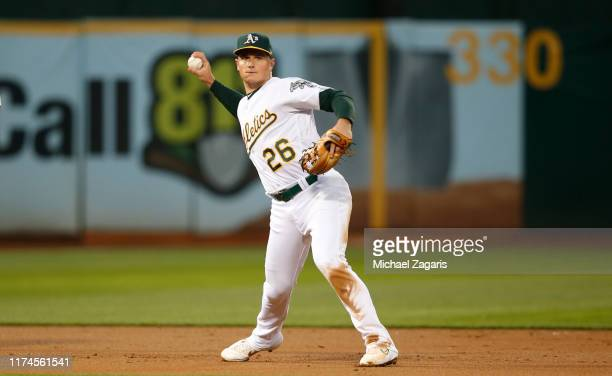 Matt Chapman of the Oakland Athletics fields during the game against the Los Angeles Angels of Anaheim at the Oakland-Alameda County Coliseum on...